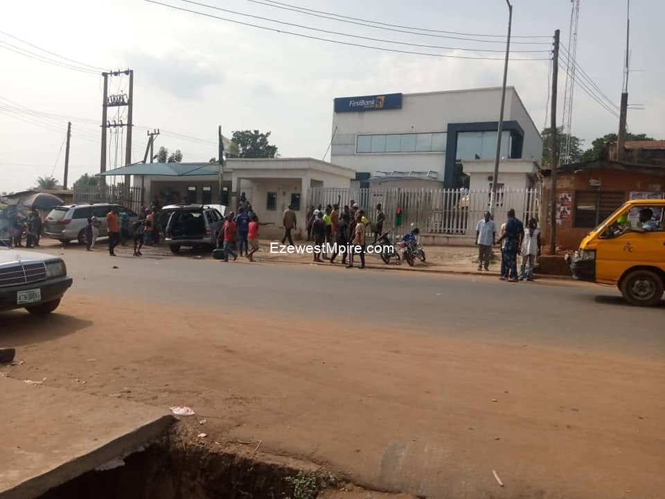 Paid Hoodlums: Unknown gunmen storm Anambra First Bank, Shot in Air, Destroy Vehicles